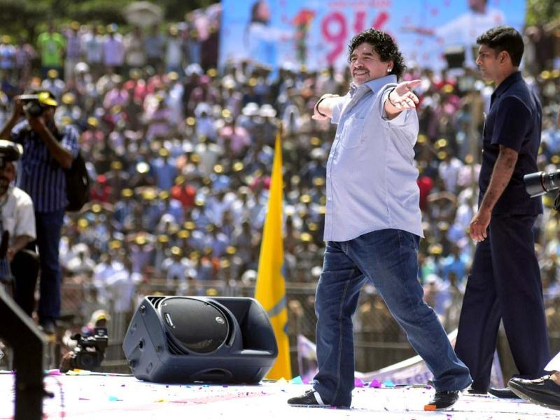 Argentine soccer legend Diego Maradona entertains fans in Kannur, Kerala. Maradona arrived on a two-day private visit. (AP Photo)