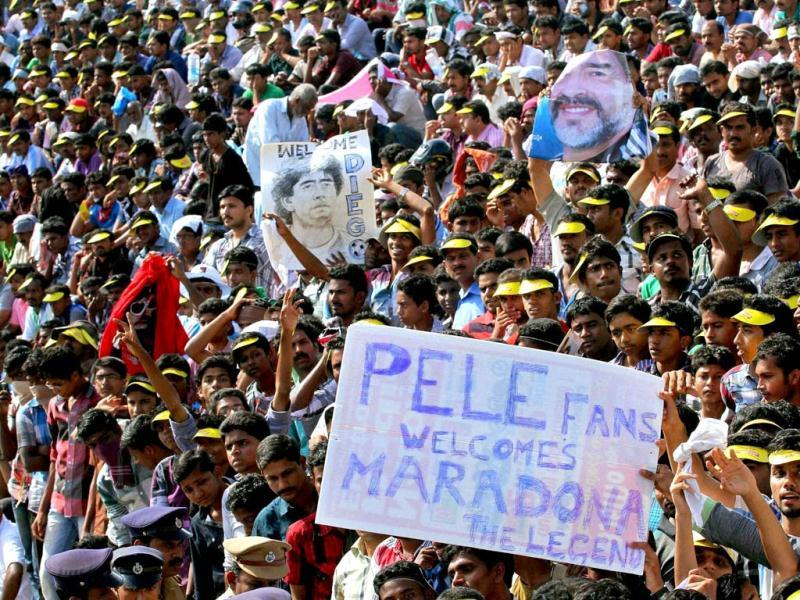 Fans gather at Jawahar Stadium to have a glimpse of footballer Diego Maradona in Kannur. PTI Photo