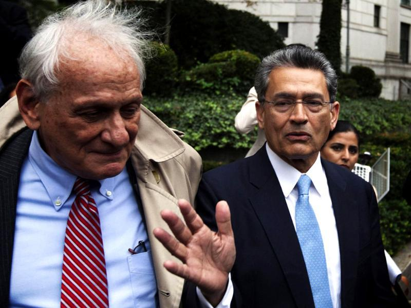 Former Goldman Sachs Group Inc board member Rajat Gupta (R) departs Manhattan Federal Court with his lawyer, Gary Naftalis (L) after being sentenced in New York. REUTERS