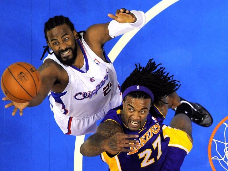 Los Angeles Clippers center Ronny Turiaf of France, left, and Los Angeles Lakers center Jordan Hill go after a rebound during the first half of their preseason NBA basketball game, in Los Angeles. (AP Photo/Mark J. Terrill)