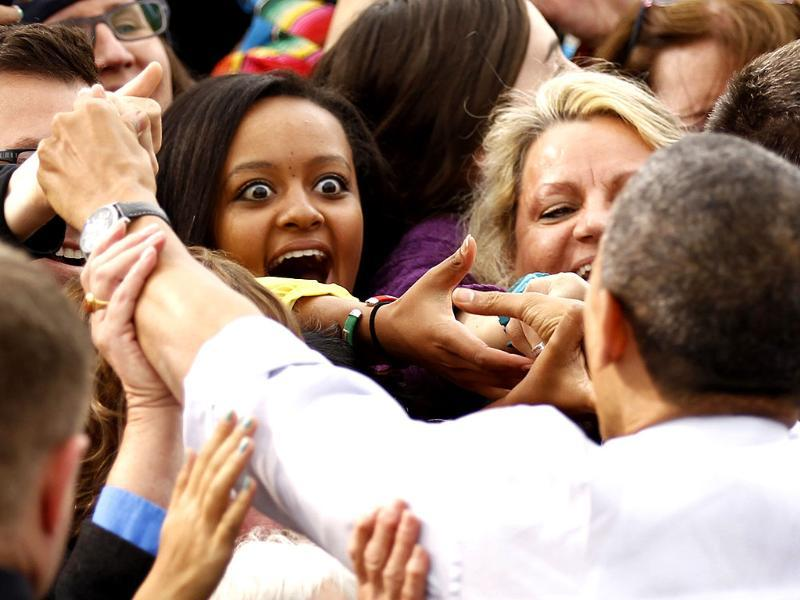 A woman reacts as she shakes hands with US President Barack Obama during a campaign rally in Denver, Colorado. Obama is on a two-day, eight state, campaign swing. REUTERS/Kevin Lamarque