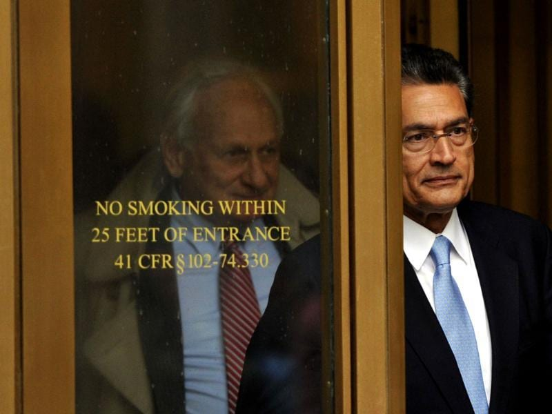 Former head of global consulting firm McKinsey & Co. and former director at Goldman Sachs Group, Rajat Gupta (R) leaves federal court with his lawyer Gary Naftalis in New York. AFP/Timothy A. Clary