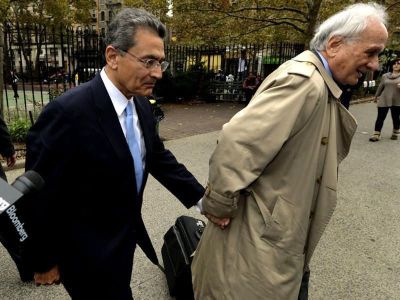 Former head of global consulting firm McKinsey & Co. and former director at Goldman Sachs Group, Rajat Gupta (L) arrives at federal court with his lawyer Gary Naftalis in New York. AFP/Timothy A. Clary