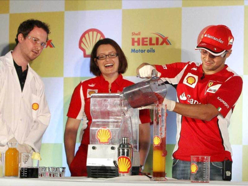 Ferrari driver Felipe Massa of Brazil makes a mocktail during previews for the Indian Formula One Grand Prix in Greater Noida. PTI Photo