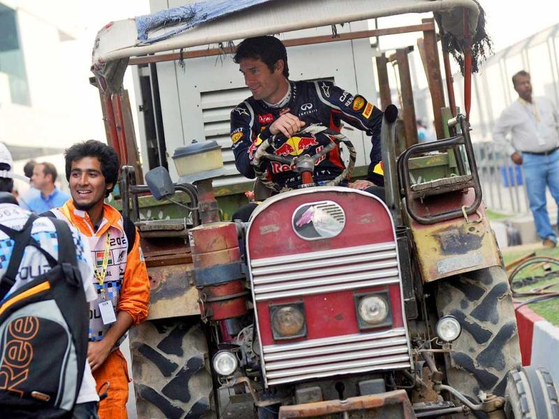 Red Bull-Renault driver Mark Webber of Australia poses in a tractor at the Buddh International circuit in Greater Noida. AFP Photo