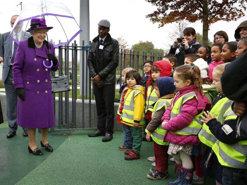 Britain's Queen Elizabeth looks at school children in a playground at the opening of the recently re-built Jubilee Gardens in London. Reuters/Peter Macdiarmid