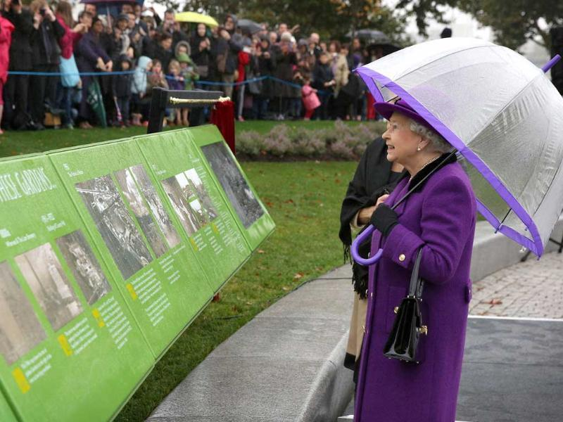Queen Elizabeth II attends the opening of the recently re-built Jubilee Gardens in London. The recent transformation of the Jubilee Gardens was completed 35 years after they were first created in 1977 to celebrate the Queen's silver jubilee. AFP/Peter Macdiarmid