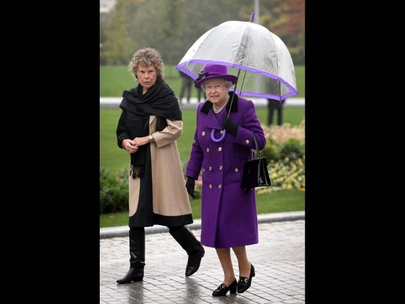 Queen Elizabeth II walks with local Member of Parliament Kate Hoey at the opening of the recently re-built Jubilee Gardens in London. AFP/Peter Macdiarmid