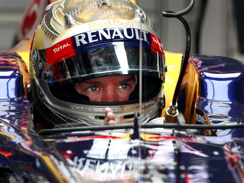 Sebastian Vettel waits in his pit garage during the first practice session for the Indian Formula One Grand Prix at the Buddh International Circuit in Noida. AP Photo