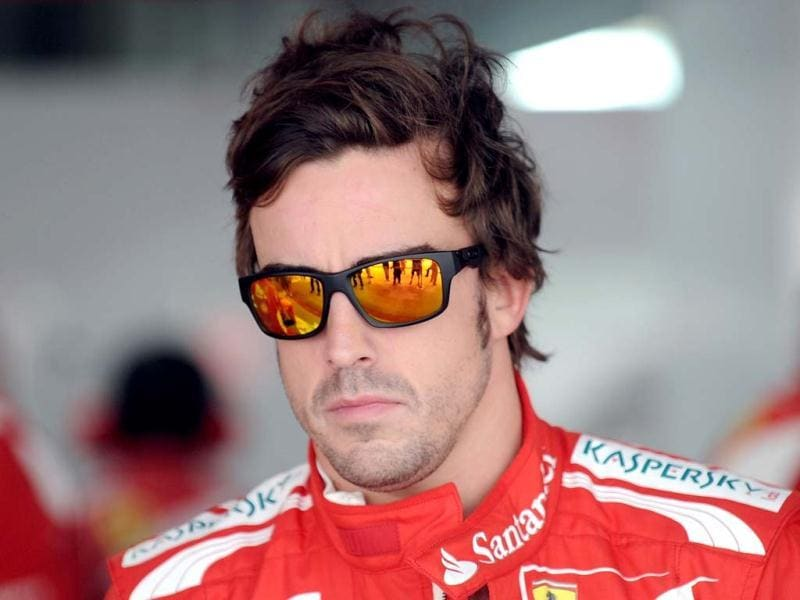 Ferrari driver Fernando Alonso of Spain takes a break during the first practice session at the Buddh International circuit in Greater Noida, on the outskirts of New Delhi ahead of the Formula One Indian Grand Prix 2012. The Formula One Indian Grand Prix 2012 will take place on October 28. AFP Photo