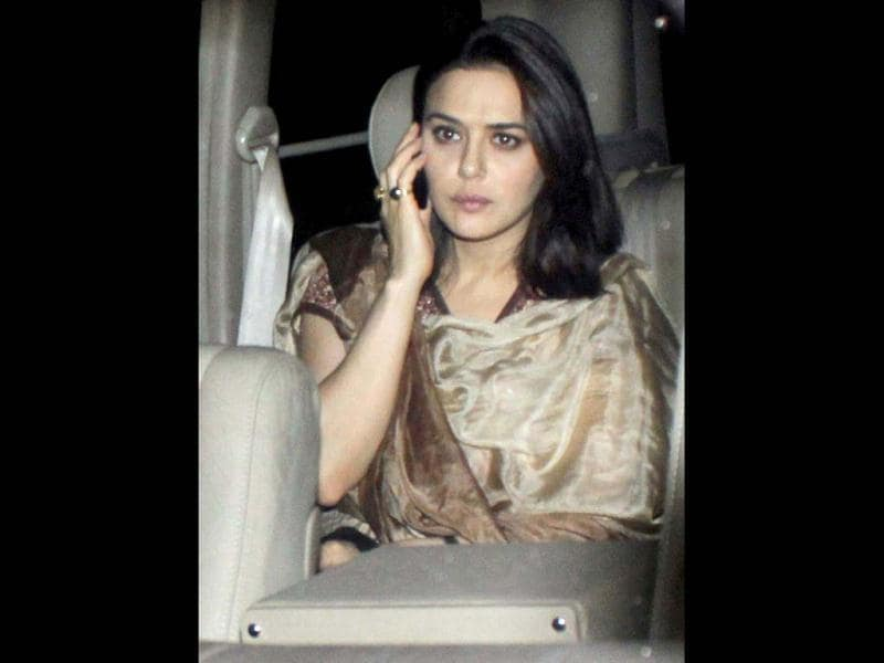 Preity Zinta talks on phone as she arrives for Yash Chopra's Chautha ceremony.