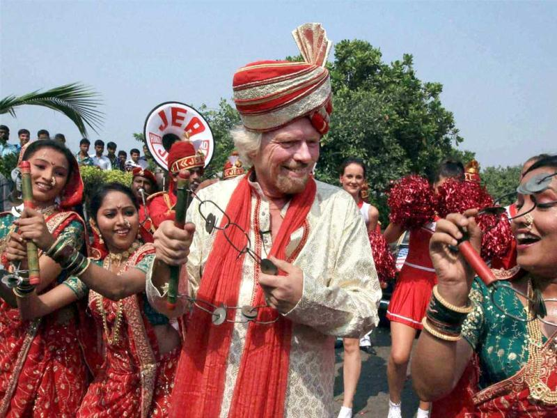 Owner of Virgin Group Richard Branson performs as he arrives for the launch of Virgin Atlantic's service on the Mumbai-London route, in Mumbai. PTI Photo/Shashank Parade