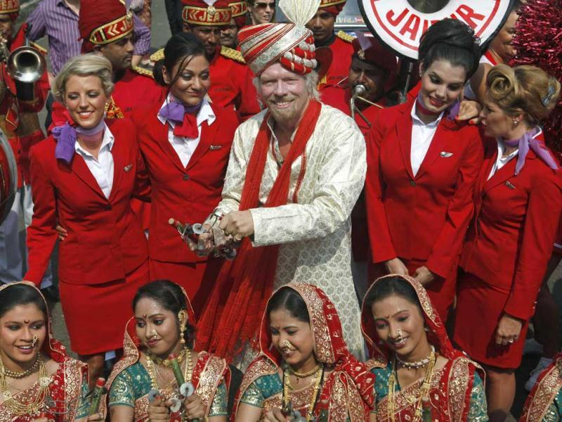 Virgin Group founder Richard Branson poses with his crew members and a group of Indian folk artists during a promotional event in Mumbai. Reuters/Danish Siddiqui