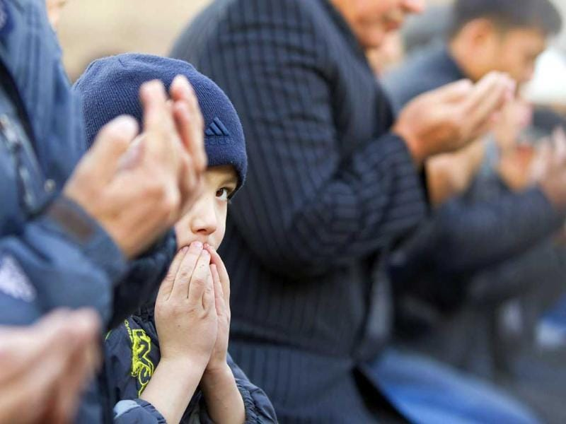 A boy looks on during Kurban-Ait, also known as Eid al-Adha in Arabic, prayers in front of Central Mosque in Almaty. Reuters/Shamil Zhumatov