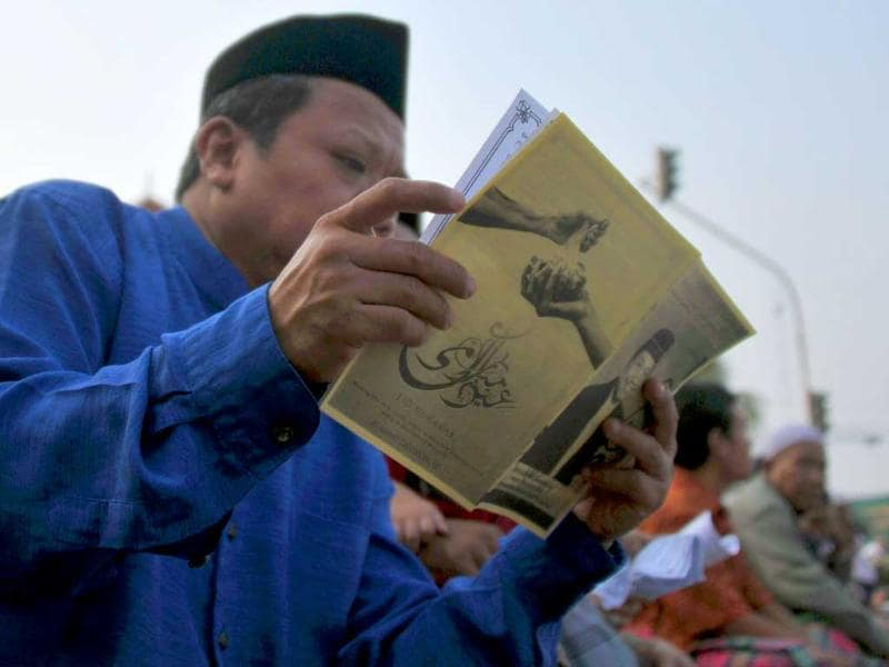 A man reads a religious book during prayers in Jakarta ahead of the Muslim feast of Eid al-Adha. AFP/Bay Ismoyo
