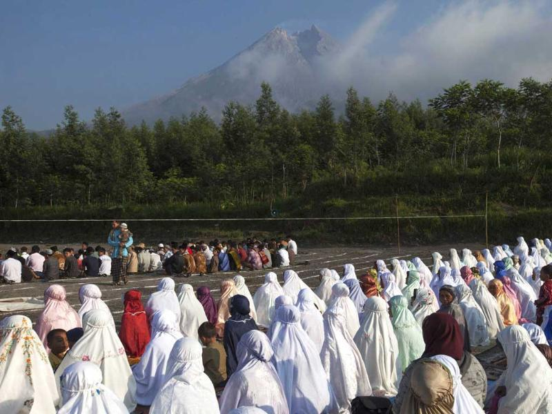 Muslim attend a mass prayer on Eid al-Adha festival in Kalitengah village, on the slopes of volcano Mount Merapi, Yogyakarta. Reuters/Dwi Oblo
