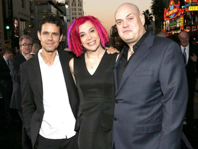 The Wachowski siblings (L-R): Co-directors Tom Tykwer, Lana Wachowski and Andy Wachowski pose for reporters at the Los Angeles premiere of Cloud Atlas at Grauman's Chinese Theatre.