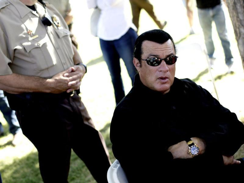 Steven Seagal waits to introduce Maricopa County Sheriff Joe Arpaio (not pictured) during a campaign rally for Arpaio in Mesa, Arizona. Reuters Photo