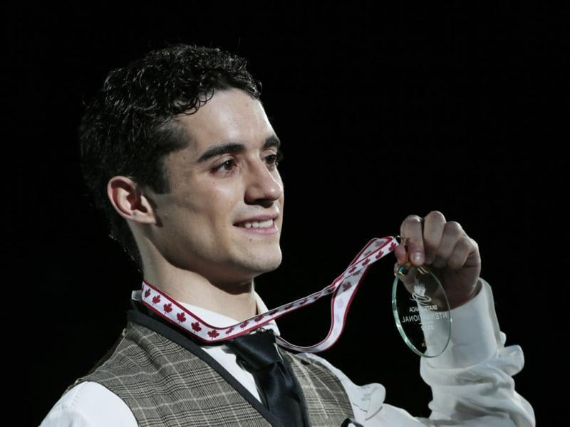 Gold medalist Javier Fernandez of Spain shows off his medal during the mens victory ceremony at the 2012 Skate Canada International ISU Grand Prix event in Windsor. AFP Photo