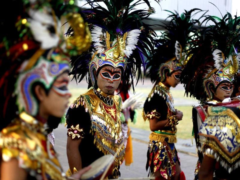Performers prepare to perform during a cultural parade held to commemorate Youth Pledge Day in Jakarta. AP Photo