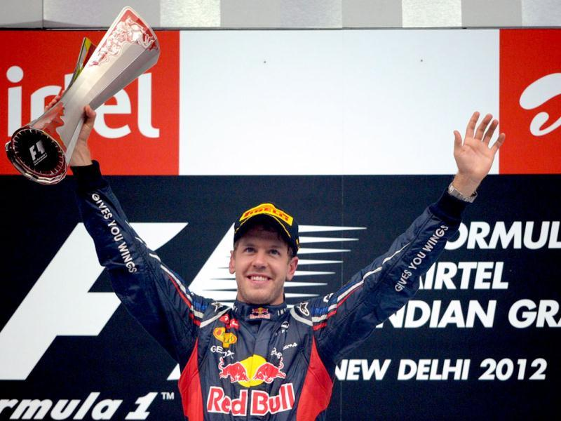 Winner Red Bull-Renault driver Sebastian Vettel of Germany gestures with the trophy at the F1 Indian GP at The Buddh International circuit in Greater Noida. AFP Photo