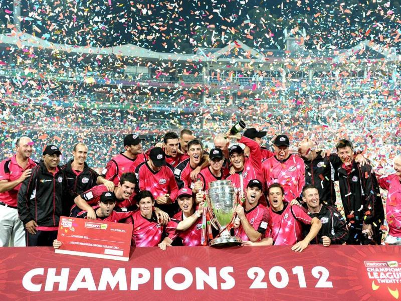 Sydney Sixers's squad celebrates their victory over the Highveld Lions on during the final Champions League T20 (CLT20) match at the Wanderers Stadium in Johannesburg. AFP Photo / Stephane De Sakutin