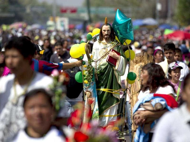 A statue of Saint Jude, the Catholic saint of lost causes, is seen on the surroundings of the church of San Hipolito in Mexico City. Thousands flocked to the church of San Hipolito as part of an annual pilgrimage honoring Saint Jude. (AP Photo)