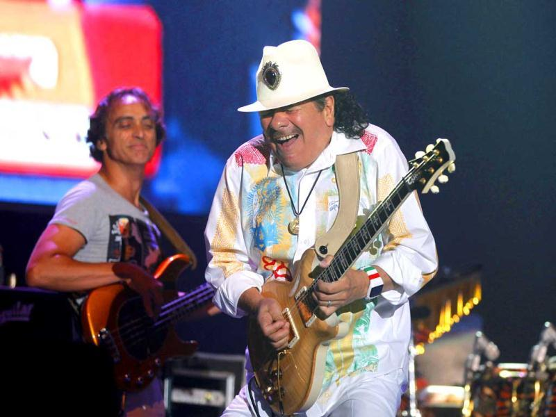 Musician Carlos Santana performs during his concert in Noida, on the out skirts of New Delhi. (AP Photo)