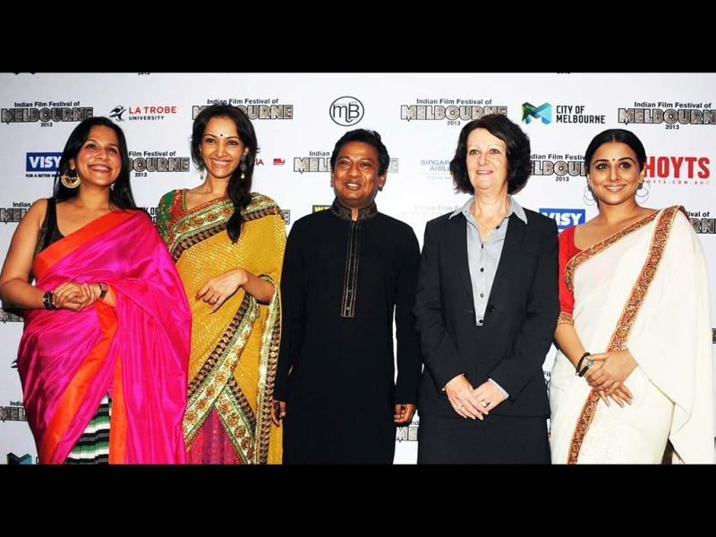 Dipannita Sharma (2L), Bollywood director Onir (C) , Australian Minister for Tourism in Victoria, Louise Asher (2R), and Bollywood actress and brand ambassador for Melbourne's Indian Film Festival, Vidya Balan, pose for a photo. (AFP)