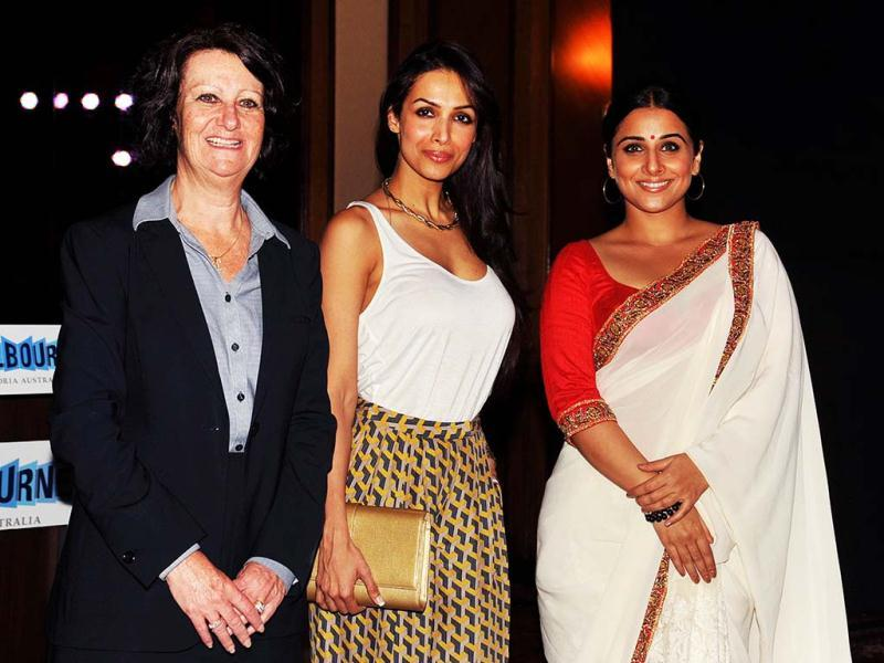 Australian Minister for Tourism in Victoria, Louise Asher (L), Bollywood actress Malaika Arora Khan (C), and Bollywood actress and brand ambassador for Melbourne's Indian Film Festival, Vidya Balan, pose for a photo during the announcement of the brand ambassador in Mumbai. (AFP)