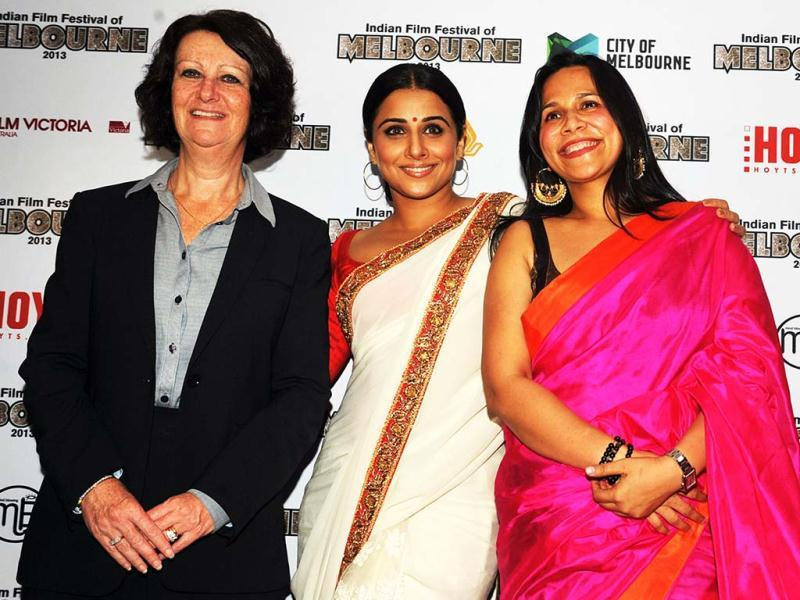 Australian Minister for Tourism in Victoria, Louise Asher (L), Bollywood actress and brand ambassador for Melbourne's Indian Film Festival, Vidya Balan (C), and Australian Mitu Bhowmick Lange pose for a photo during the announcement of the brand ambassador. (AFP)