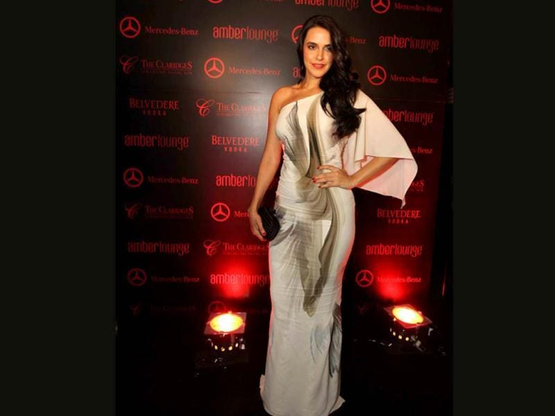 Neha Dhupia looks nice in an off shoulder long dress.