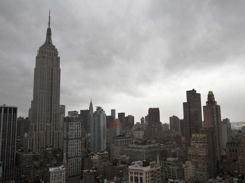 Storm clouds loom over the Empire State Building and Manhattan skyline in New York as Hurricane Sandy continued on its path forcing a mass shutdown. AP Photo