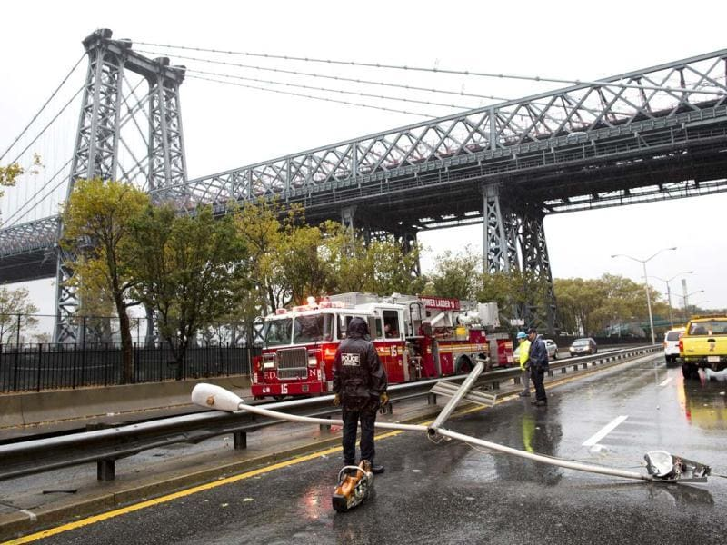 Police and firefighters respond to a downed street light on FDR drive in New York as Hurricane Sandy continued on its path forcing a shutdown of mass transit. AP Photo