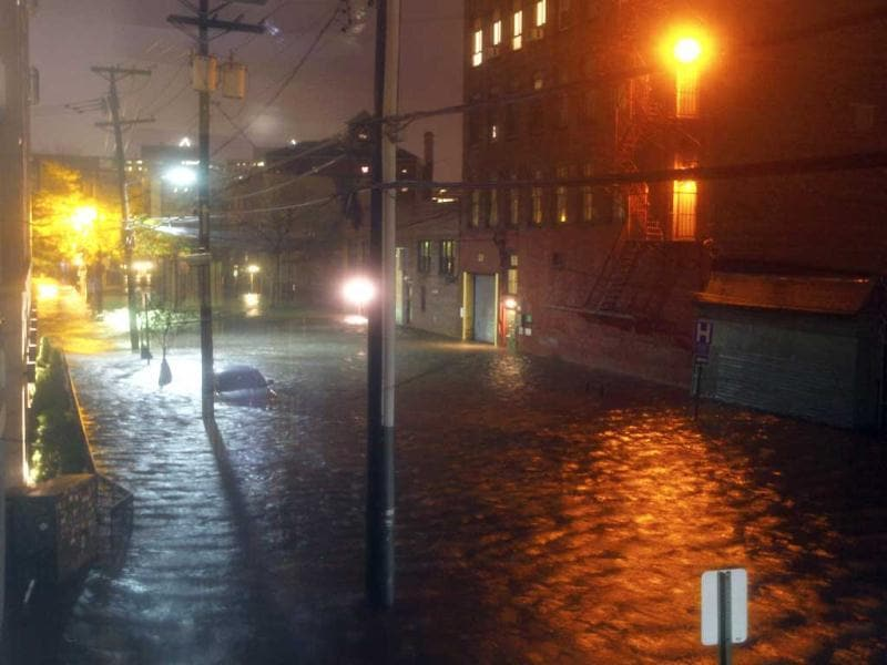 Flood waters surround a car parked on a street in Hoboken, New Jersey. Sandy, one of the biggest storms ever to hit the United States, roared ashore with fierce winds and heavy rain near Atlantic City, New Jersey after forcing evacuations, shutting down transportation and interrupting the presidential campaign. Reuters photo