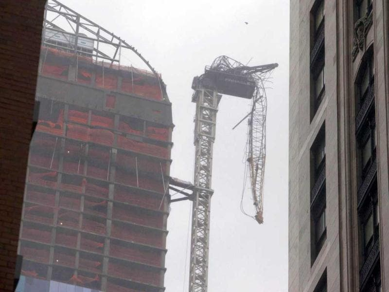 A collapsed crane dangles beside a building under construction, as superstorm Sandy made its approach, in New York. Reuters photo