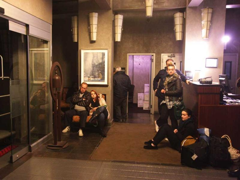 People wait in the lobby of the Hampton Inn Manhattan-SoHo after the power went out in New York City. AFP