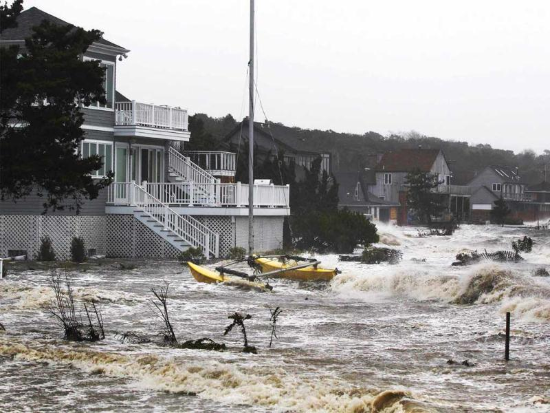 Storm surf kicked up by the high winds from superstorm Sandy break onto homes in Southampton, New York. Reuters photo
