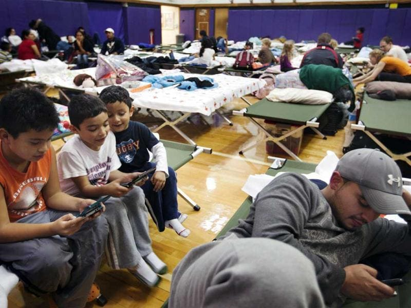 Young boys play video games while in the sleeping area of a Red Cross shelter in Hampton Bays, New York. Reuters photo