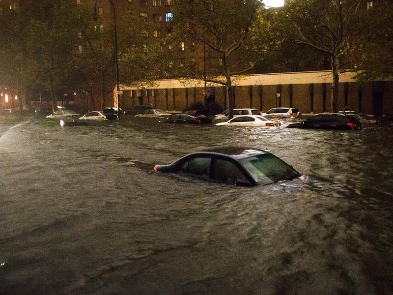 Many vehicles are submerged on 14th Street near the Consolidated Edison power plant in New York. AP photo