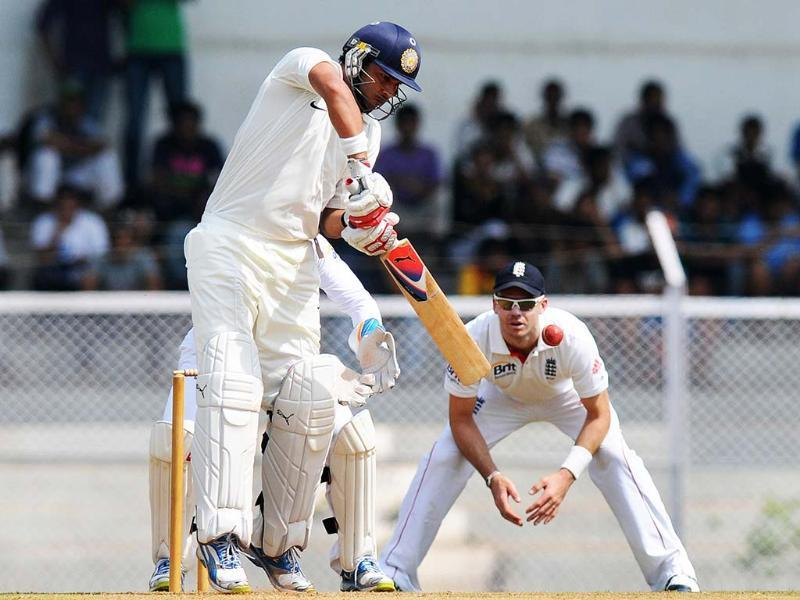 India A cricketer Yuvraj Singh (L) bats during the first day of a three-day practice match between India A and England at the Cricket Club of India (CCI) grounds in Mumbai. AFP Photo/Pal Pillai