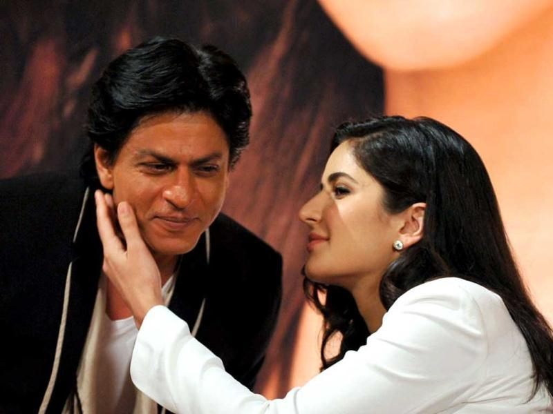 Bollywood actor Shah Rukh Khan (L) is embraced by actress Katrina Kaif during a promotional event for Jab Tak Hai Jaan. (AFP)