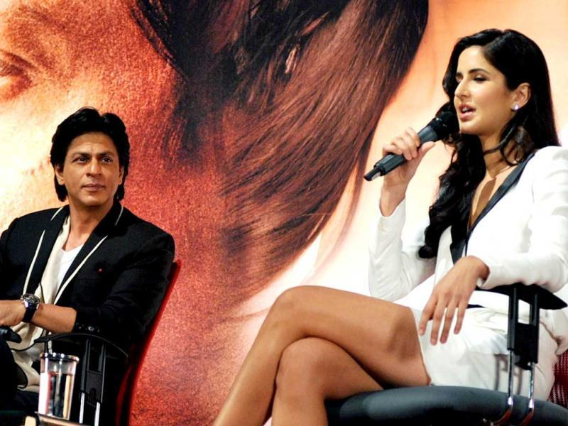 Bollywood actor Shah Rukh Khan (L) looks on as actress Katrina Kaif addresses the audience during a promotional event for Jab Tak Hai Jaan. (AFP)