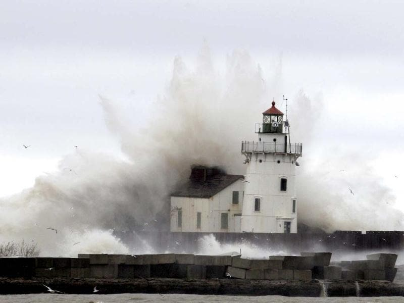 Waves pound a lighthouse on the shores of Lake Erie near Cleveland. AP Photo