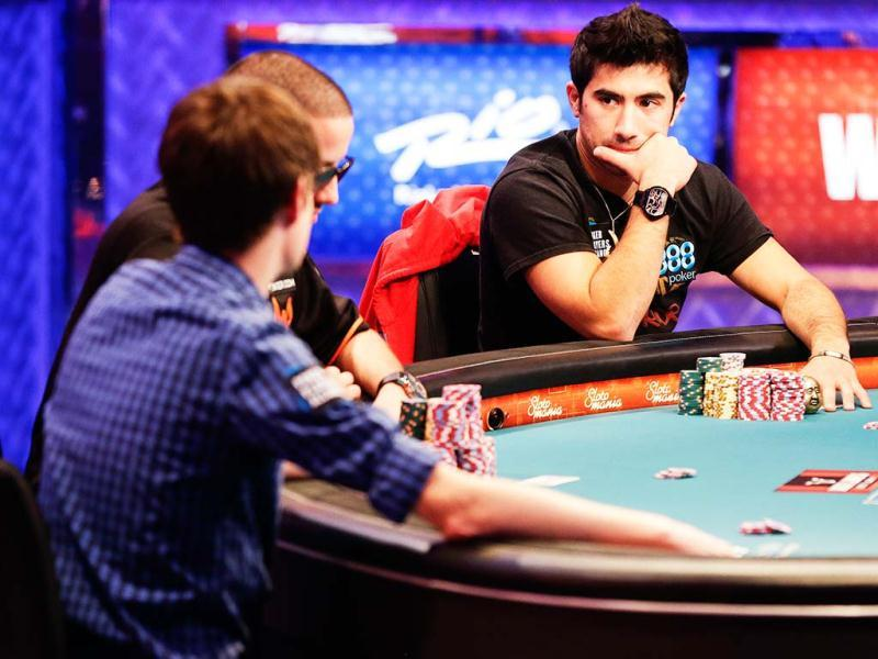 Jesse Sylvia, right, watches early play from opponents during the World Series of Poker Final Table event in Las Vegas. AP Photo/Julie Jacobson
