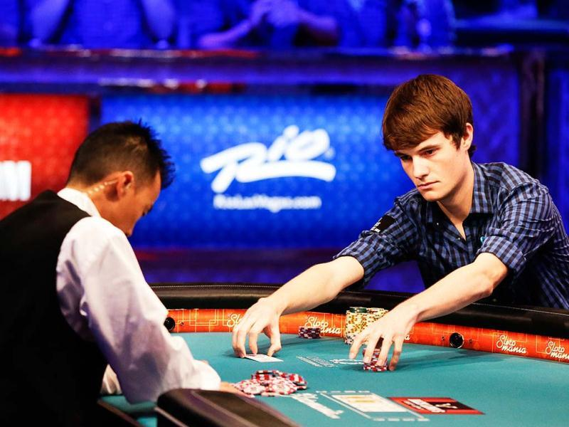 Jake Balsiger pulls in the pot after winning a hand during the World Series of Poker final table in Las Vegas. AP Photo/Julie Jacobson