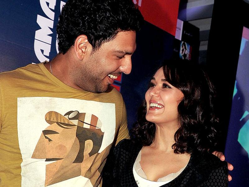 Preity Zinta and Indian cricketer Yuraj Singh chat at the event. (AFP Photo)