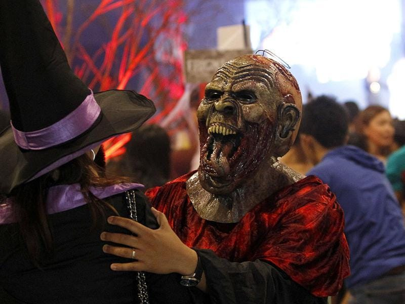 A man with a mask joins Halloween celebration at a mall in Manila. REUTERS/Cheryl Ravelo