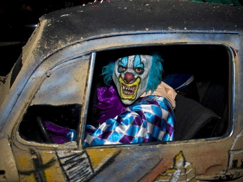 A man dressed up as a clown drives a car during the Halloween night in Mexico city. AFP/Ronaldo Schemidt