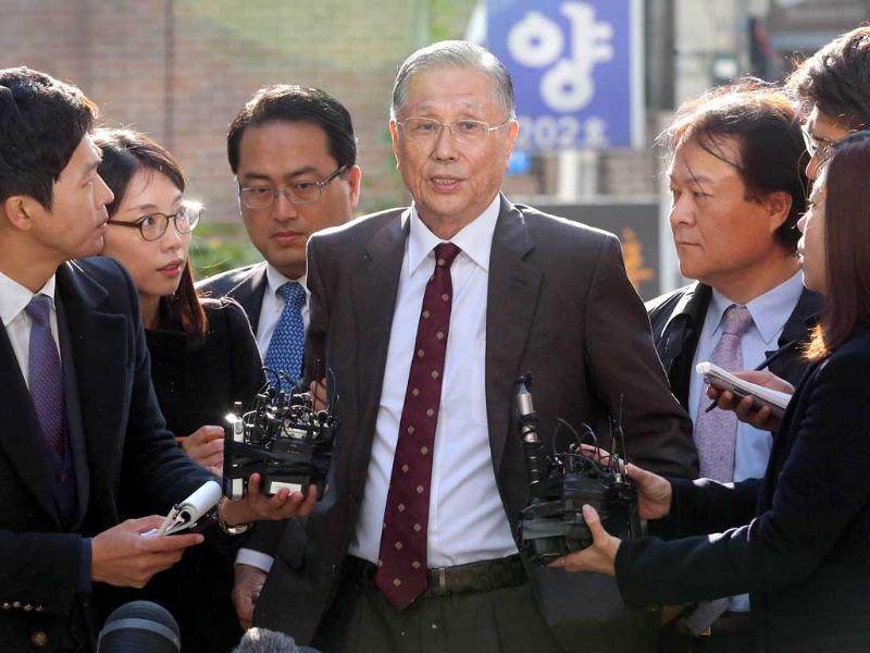 Lee Sang-Eun, brother of South Korean President Lee Myung-Bak, is surround by media after arriving at a special prosecutor office in Seoul. AFP/Yonhap
